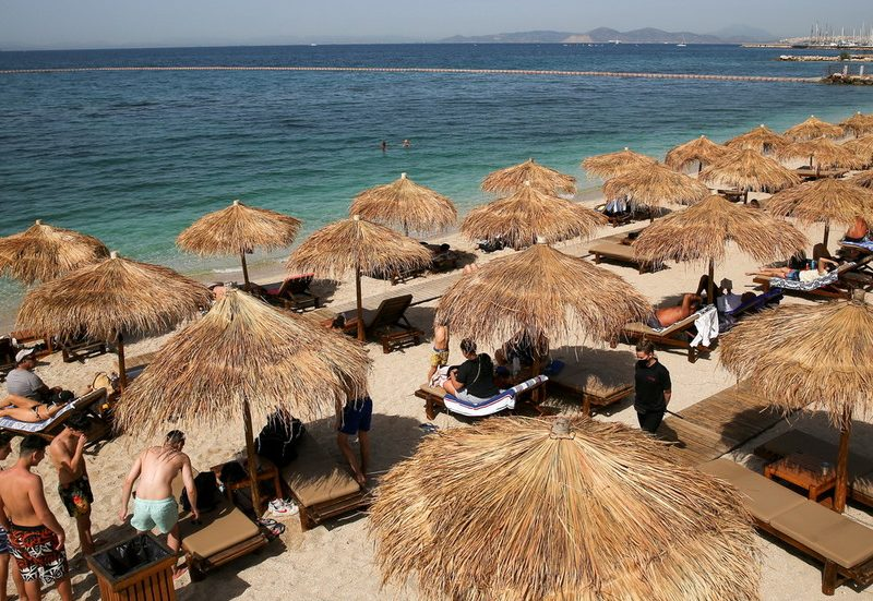 Solar's out, masks off: Greece scraps obligatory face masking rule outdoor in time for summer time, as Covid threat drops